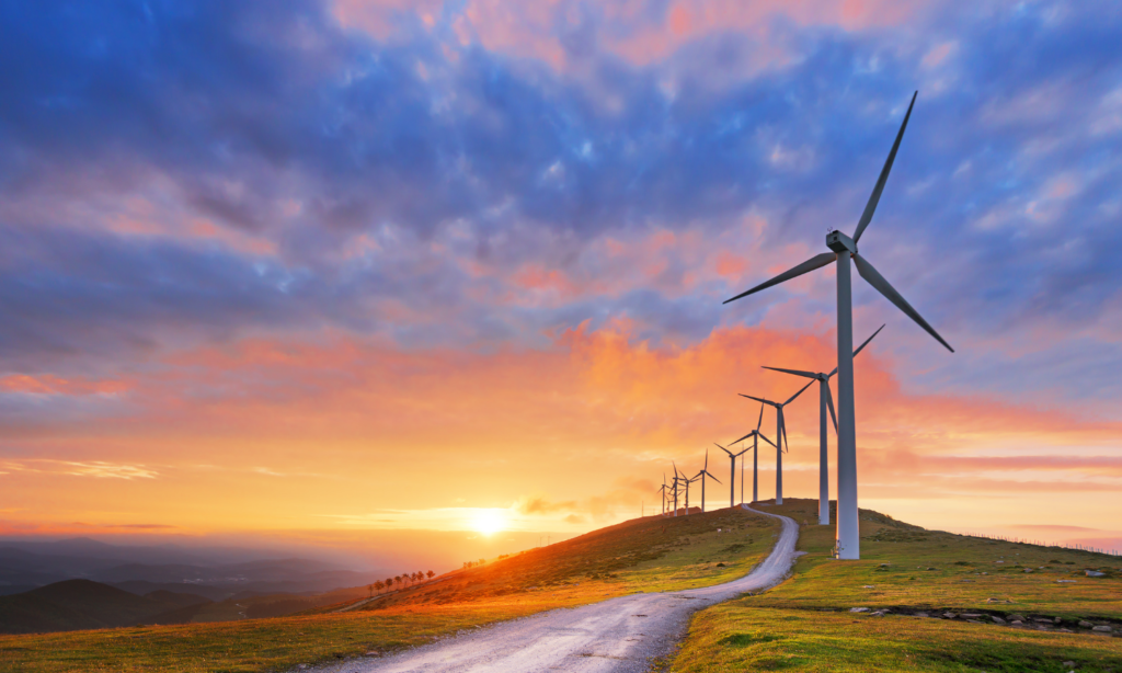 Wind turbines with a sunset in the background.